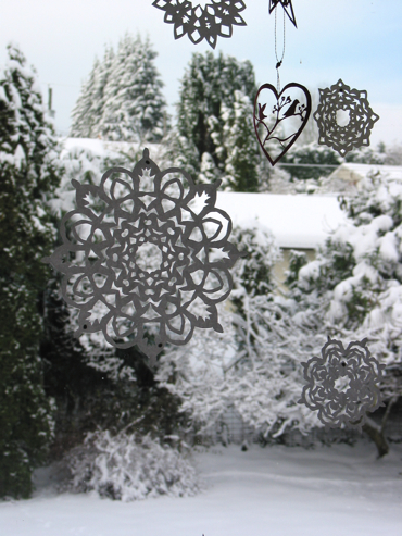 Decorations in window with snow